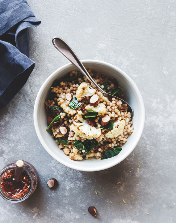 Toasted couscous salad with cauliflower and sun-dried tomato pesto recipe by Chantelle Grady