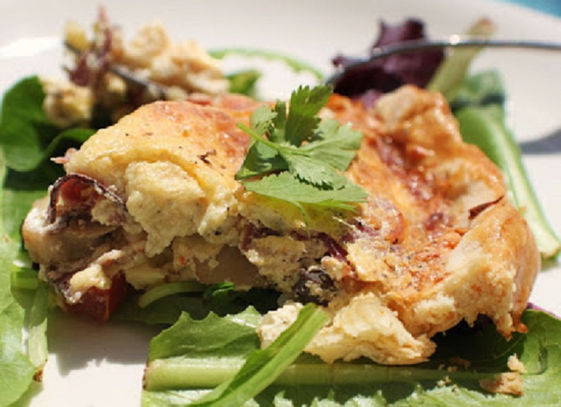Zucchini Mushrooms with a egg filling called quiche made with cheeses in a golden baked crust