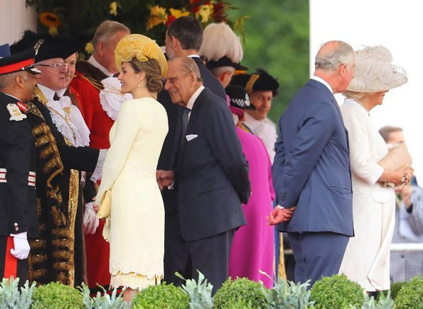 King Felipe, Queen Letizia welcomed by Queen Elizabeth II, Prince Philip, Prince Charles and Duchess Camilla. Felipe Varela dress, Prada pumps