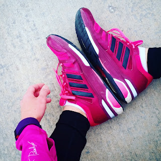 Pink fucshia running shoes and plum Fitbit Charge HR fitness watch