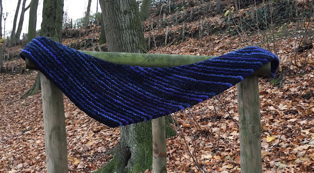 Knitted scarf with blue and black stripes