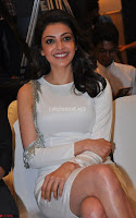 Beautiful Smiling Kajal Aggarwal in Creamy White Gown at MLA Telugu Movie Success Meet ~ .com Exclusive Pics 022.jpg