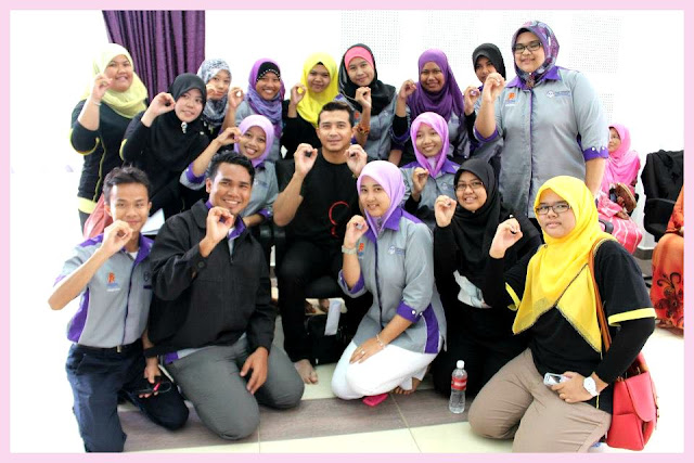 Aaron Aziz with Red Ribbon Youth