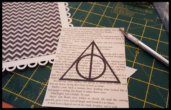 Gluing the deathy hallows on to my Harry Potter Pages