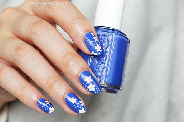 Daisy floral nail art Essie nail polish
