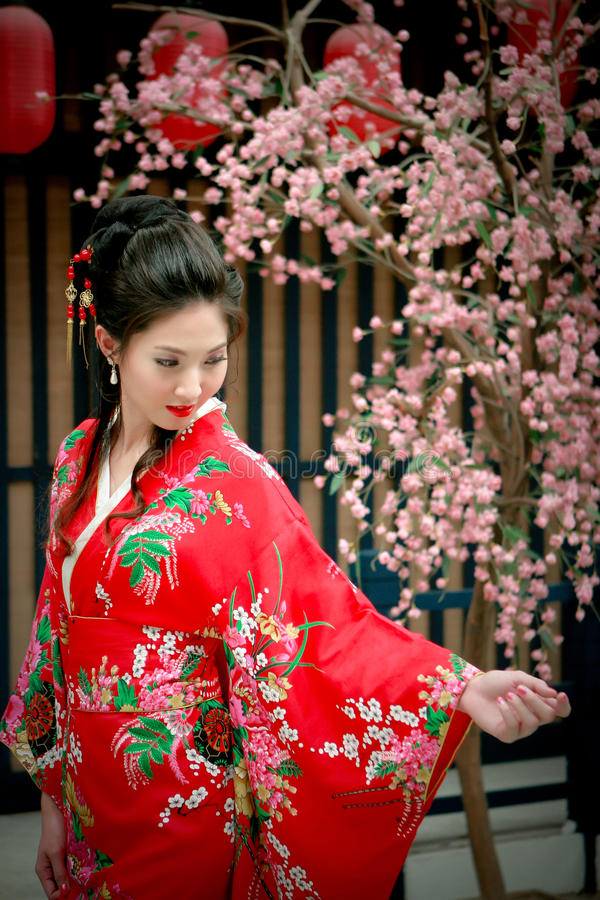 Japanese Girl In A Kimono during Sakura flowering period