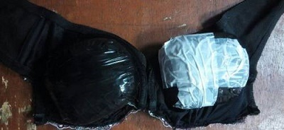 Shocking!!! Nigerian Hairstylist Caught at the Airport Hiding Cocaine in Her Bra (Photos)
