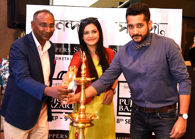 Renowned actors Parambrata Chattopadhyay and Priyanka Sarkar inaugurated the 'Shoppers Stop Sananda Pujor Bazar' Festival