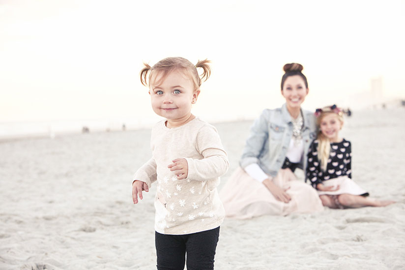 Toddler poses on the beach