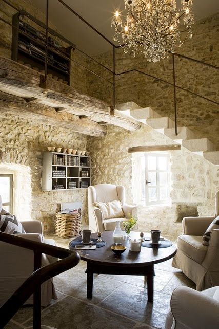 Exquisite limestone walls in #Frenchfarmhouse with delicate iron railing on stone steps and crystal chandelier on Hello Lovely Studio