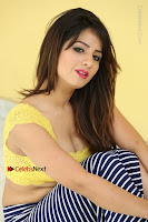 Cute Telugu Actress Shunaya Solanki High Definition Spicy Pos in Yellow Top and Skirt  0413.JPG