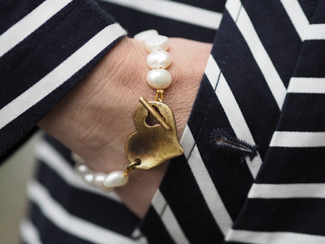 Navy and white striped trench coat, Danon freshwater pearl and heart bracelet