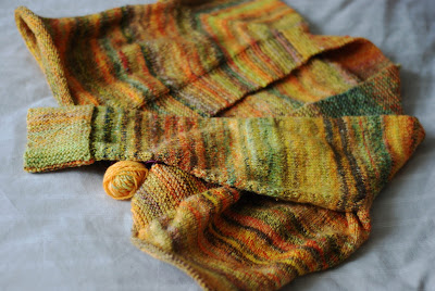 Work in progress handspun knitted sweater in yellow and orange stripes