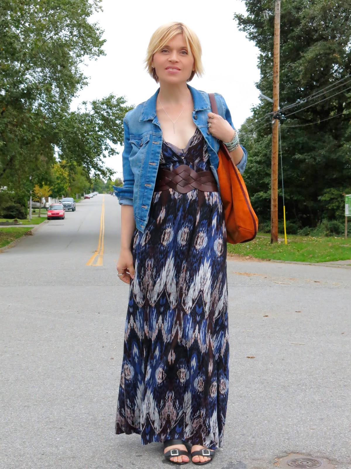 styling a printed maxi-dress with a corset belt and denim jacket