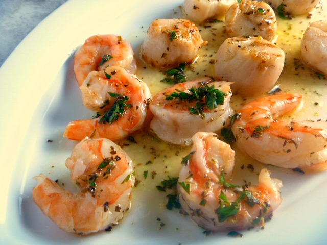Light lemony flavor combined with bright herbs bring these grilled shrimp and scallops to a whole different level that just screams summer!   - Slice of Southern