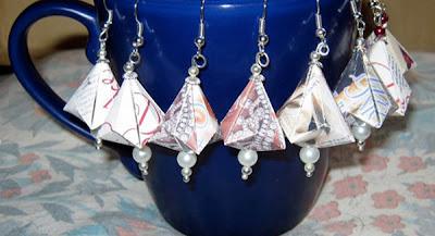 multiple pairs of German bell ornaments hanging on mug