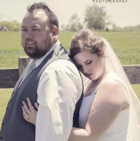 mating cows photobomb couple wedding shoot