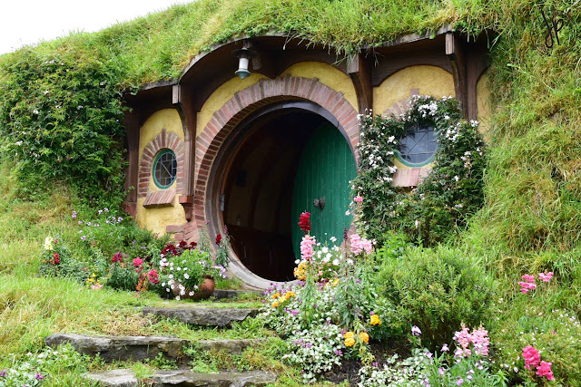 hobbit hole, green door, house, grass