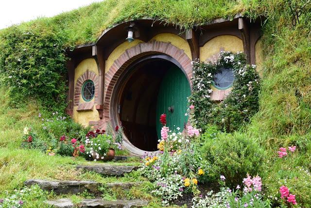 hobbit hole, green door, house, grass