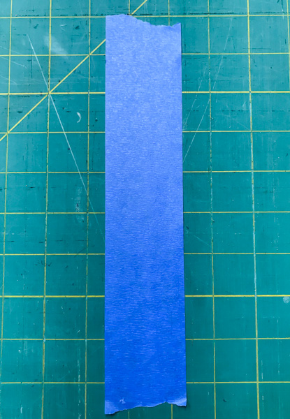 Using painter's tape to make half square triangle quilt blocks