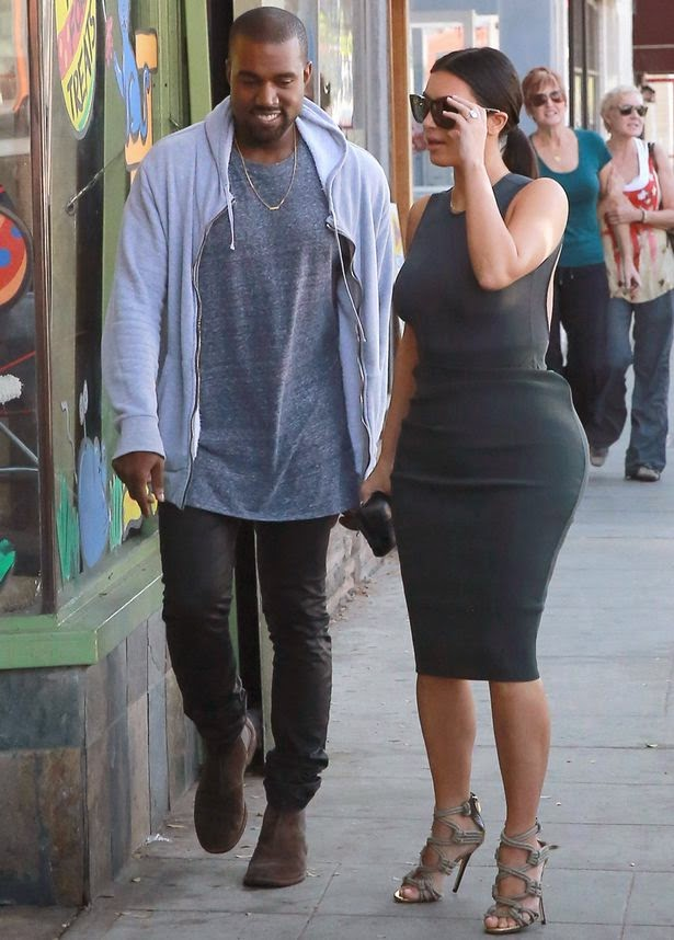 Kanye West smiles Kanye cant stop smiling on stroll with Kim hours after explaining why he doesnt smile