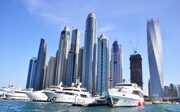 Wallpaper: Skyscrapers and Yachts in Dubai Harbor
