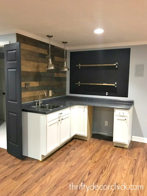 basement kitchenette with shelves