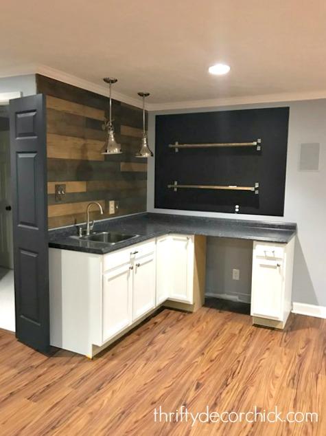 basement kitchenette with shelves