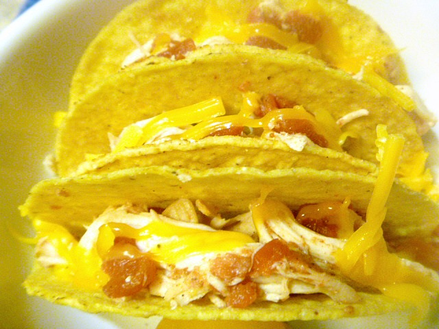 Baked Chicken Tacos: stuff the shells with cooked meat and cheese and then baking them, to crisp up the shells and get some melty cheese going.  Brilliant! - Slice of Southern
