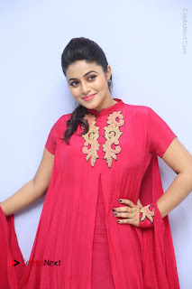 Actress Poorna Latest Stills in Red Dress at Rakshasi First Look Launch  0081.JPG