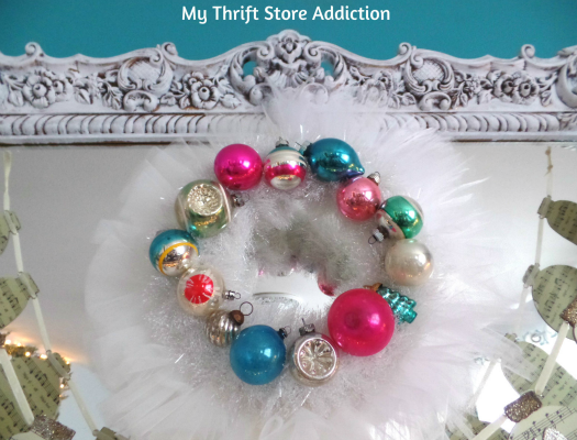 Creating Christmas: A Very Thrifty Christmas mythriftstoreaddiction.blogspot.com DIY vintage ornament wreath framed in tulle