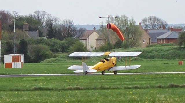 Tiger Moth G-AOEI taxying at Cambridge Airport