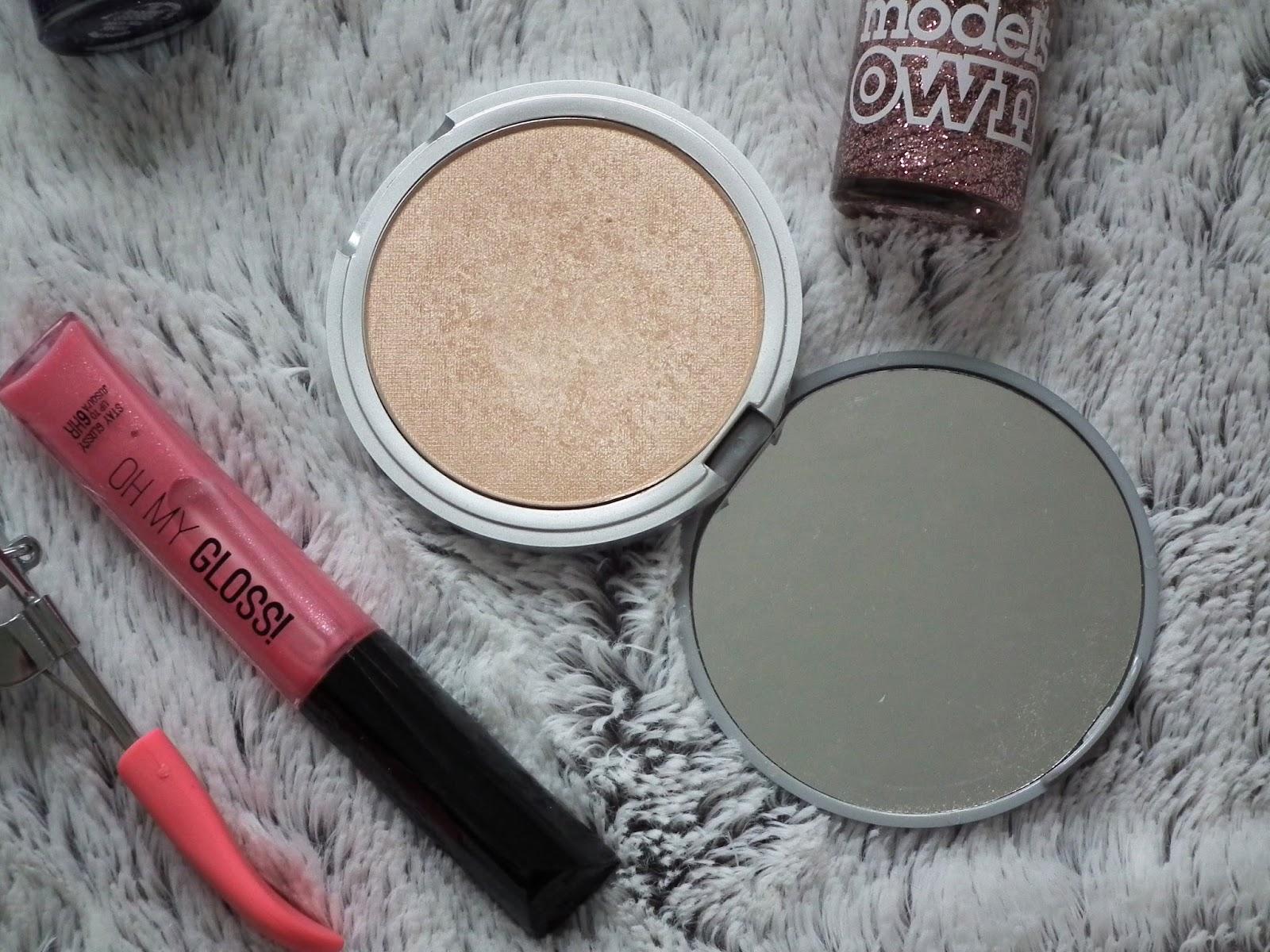Eyelash curles, lip gloss & highlighter