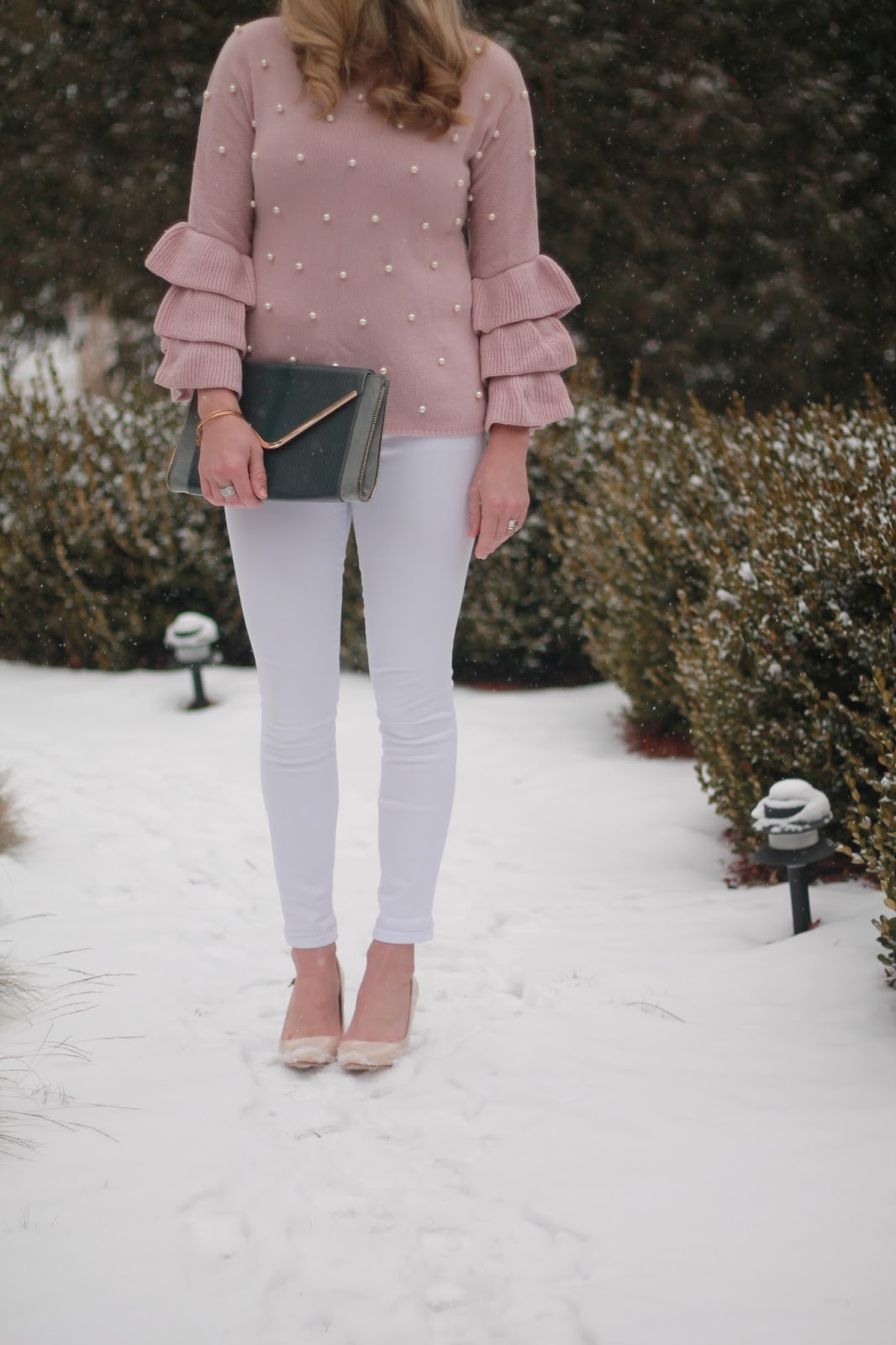 pink ruffle sleeve pearl embellished sweater, white jeans, nude heels, grey envelope clutch