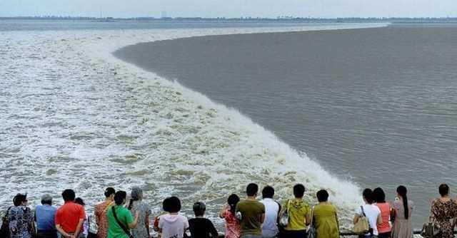 di china tsunami dan angin topan jadi tontonan
