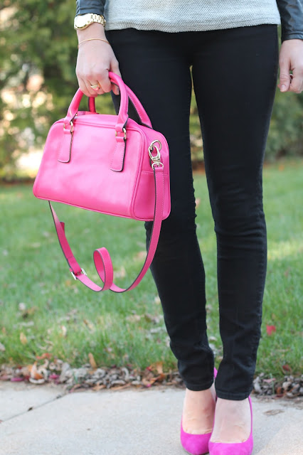 black jeans, leather sleeve sweater, pink heels, pink purse, black floppy hat