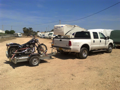Motorcycle, boat, car, trailer transport