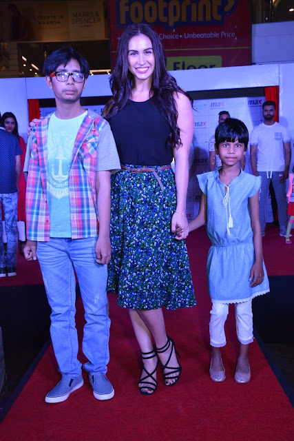 Lauren walking the ramp with the kids from Satyarth Rehab center