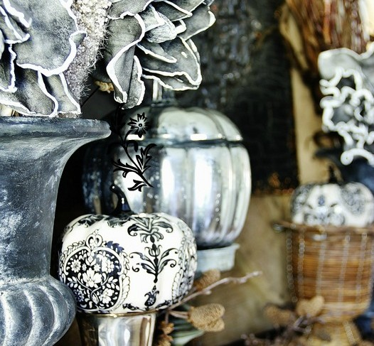 A mercury glass pumpkin is a great DIY fall craft that will look great in a halloween display in your living room - I love the silver pared with black and white