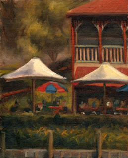 Oil painting of several large outdoor cafe umbrellas in front of an Edwardian-style timber boathouse.