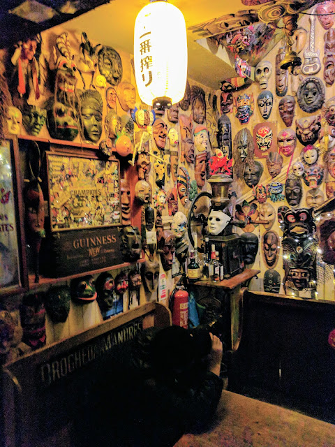 Tribal masks decorating the interior of De Barra's Folk Club in the West Cork town of Clonakilty