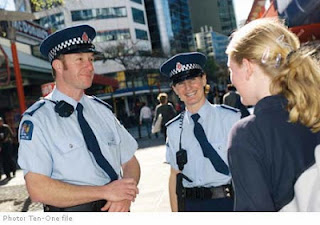 Two police officers talking to a visitors in New Zealand.