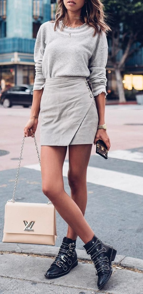 pastel street style outfit idea: top + skirt + bag + boots
