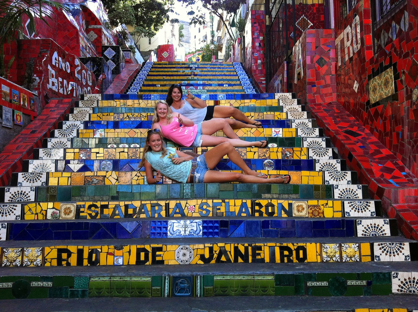 Girls laying on Escadaria Selaron in Rio de Janeiro