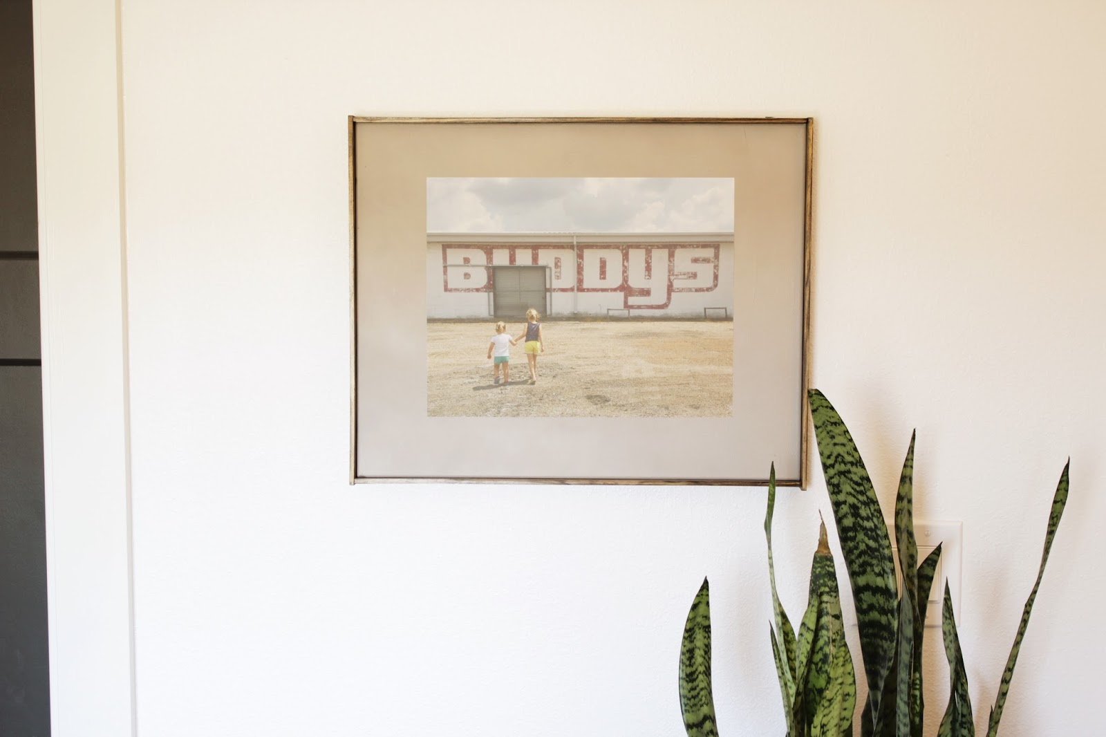 How to create a frame around a store bought canvas. Quick and easy DIY for a nice finishing touch.