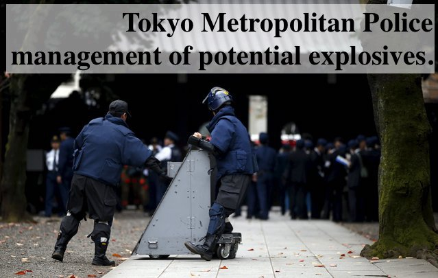 Tokyo metropolitan police responding to an explosion at the Yasukuni shrine