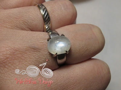 close up of handmade moonstone prong ring around my finger