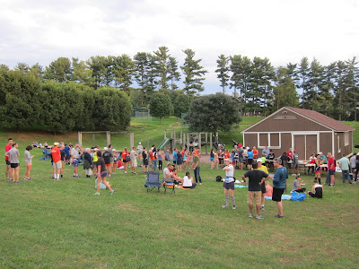 photo of DC Road Runners Club members at their 2018 picnic on the grounds of Bethesda's Landon School