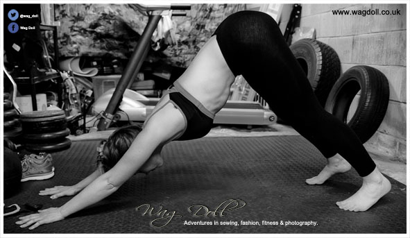 woman downward dog yoga pose