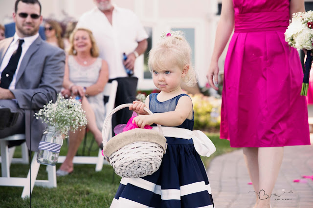 flower girl walking down the isle new baltimore waterfront wedding